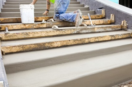 Nick's Construction and Masonry LLC mason building cement steps.